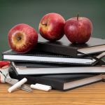 apples and chalk on a teacher's desk
