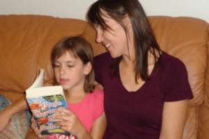 Sherry M Lee and one of her daughters reading together